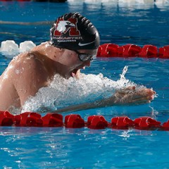 Mac shatters swim records
