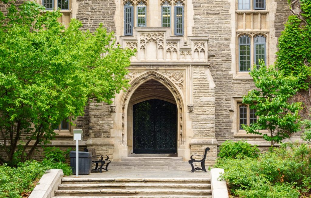 Photo of the gothic revival style University Hall at the main campus of McMaster University, a public research university in Hamilton, Ontario, Canada.