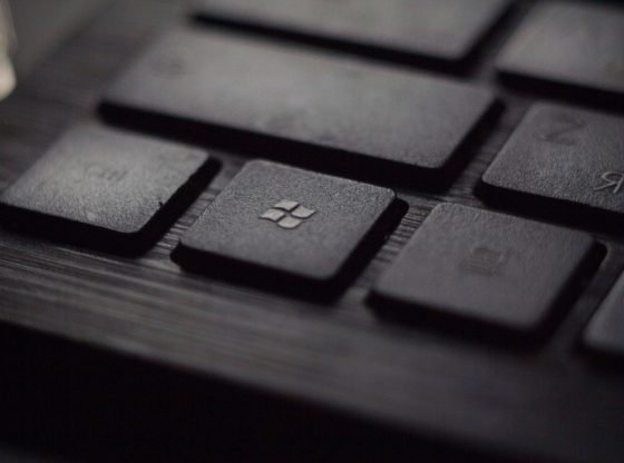 A black keyboard with the Microsoft key in focus.